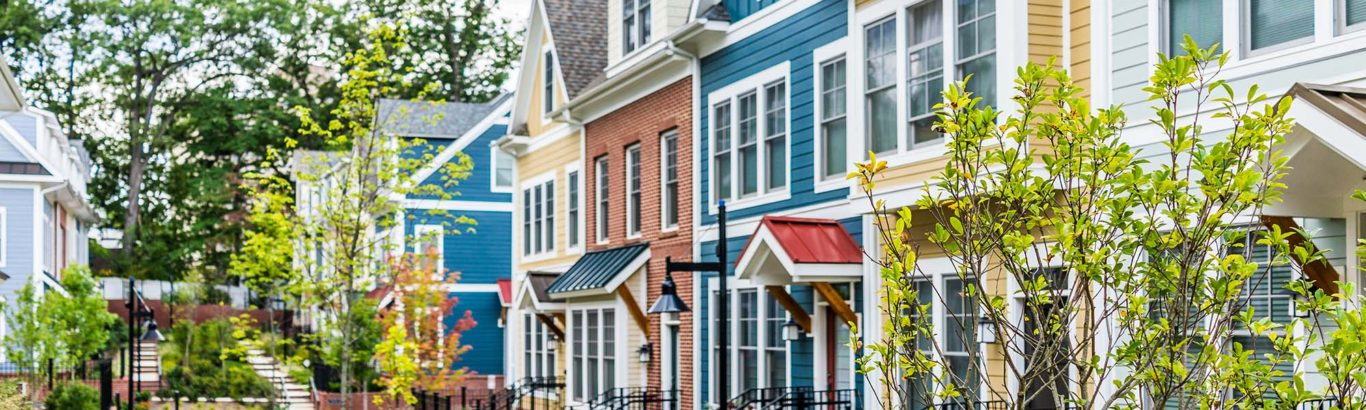 Row of colorful, red, yellow, blue, white, green painted resident